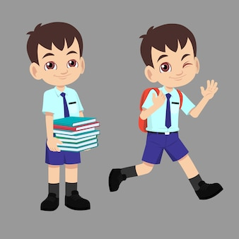 School boy in uniform going back to school carrying bag and books