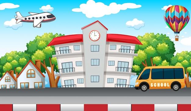School building with school bus in front