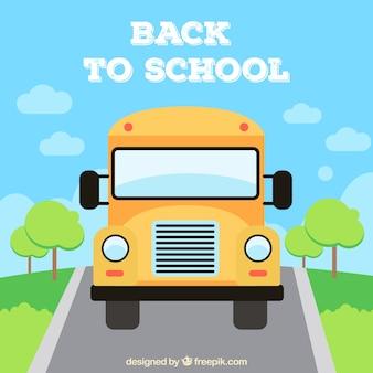 Школьный автобус, идущий в школу с плоским дизайном