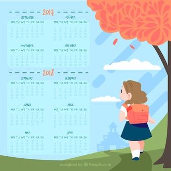 Школьный календарь с девушкой, идущей в школу