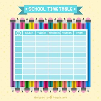 Школьный календарь с цветными карандашами в плоском дизайне