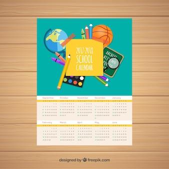Calendario scolastico con composizione dei materiali scolastici