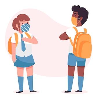 新しい通常で挨拶する小学生