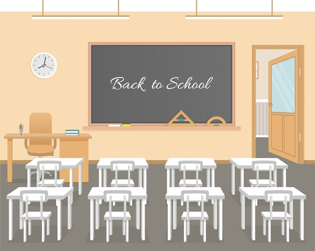 School classroom with chalkboard, white student desks and teacher's desk.