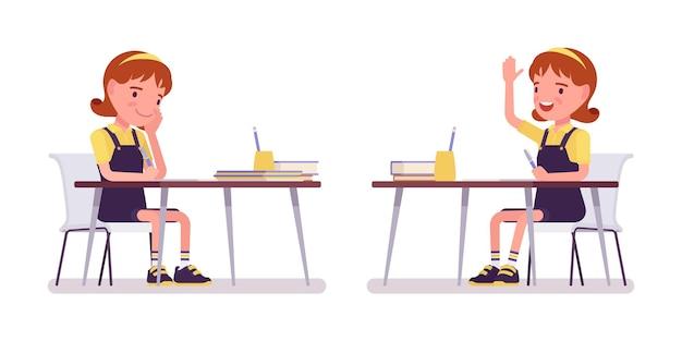 School girl studying at the desk, raise hand to speak