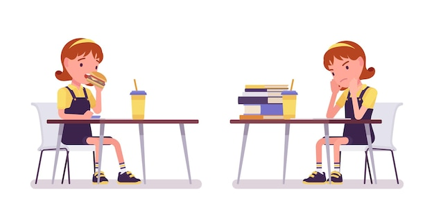 School girl studying and eating at the desk