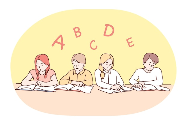 School, lesson, learning letters and alphabet, education concept. group of positive concentrated children classmates sitting with books and learning letters of english alphabet in classroom