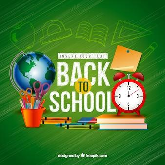 School materials, alarm clock and world globe