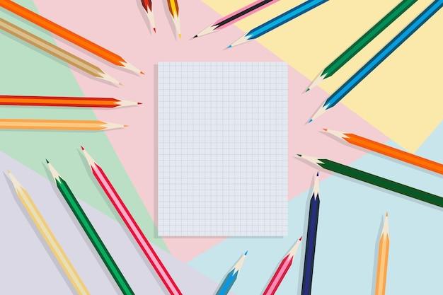 Школьная тетрадь и карандаши на разноцветном фоне концепции образования обратно в школу
