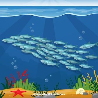 フラットスタイルの深海を背景にした魚群の学校