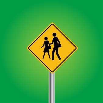 金属製のポールが付いている子供交差道路標識板が付いている学校または歩行者