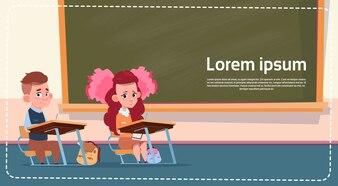 School Sall Girl And Boy Sitting At Desk