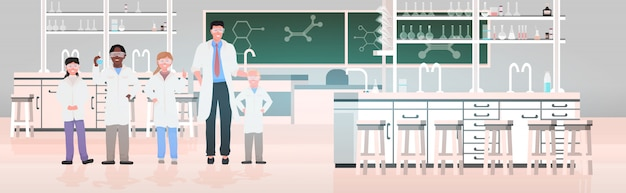 School students with teacher in uniform working in chemical laboratory modern science classroom interior horizontal full length