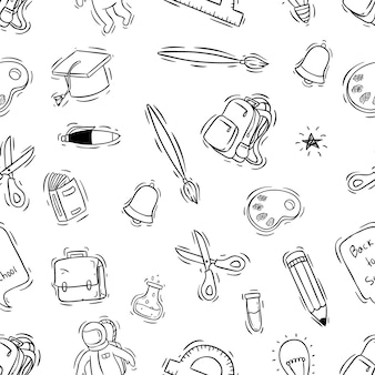 School supplies in seamless pattern with doodle style