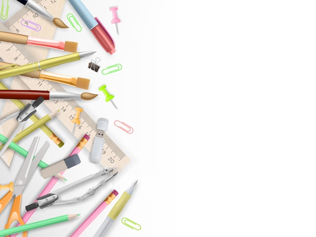 School supplies on white with copyspace.