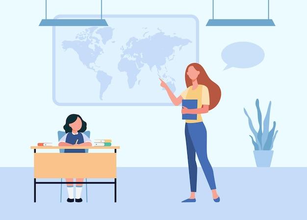 학생에게 지리 수업을 설명하는 학교 교사. 학생 아이에게 세계지도를 보여주는 교사