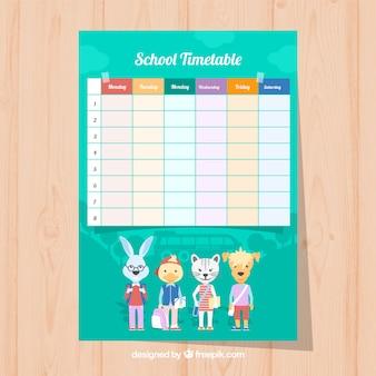 学校の時刻表と服を着た動物