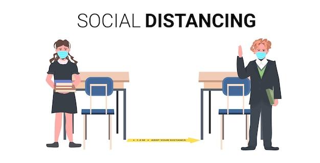 Schoolchildren in masks keeping distance to prevent coronavirus pandemic social distancing concept horizontal