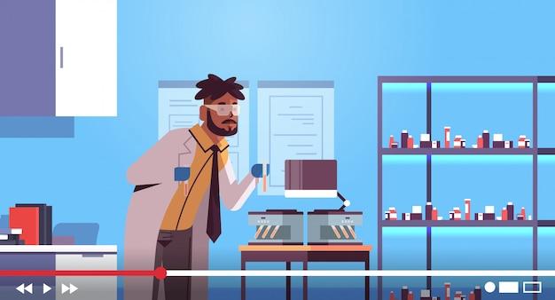 Scientific researcher using microscope man blogger making experiment