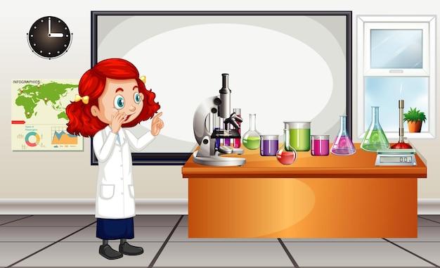 방에 있는 실험실 장비를 보고 있는 과학자