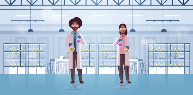 Scientists couple holding test tubes with liquids