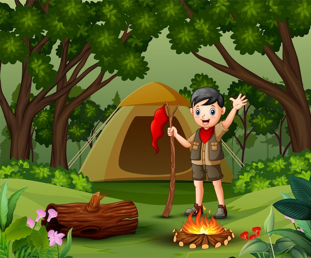 Scout boy camping out in the forest