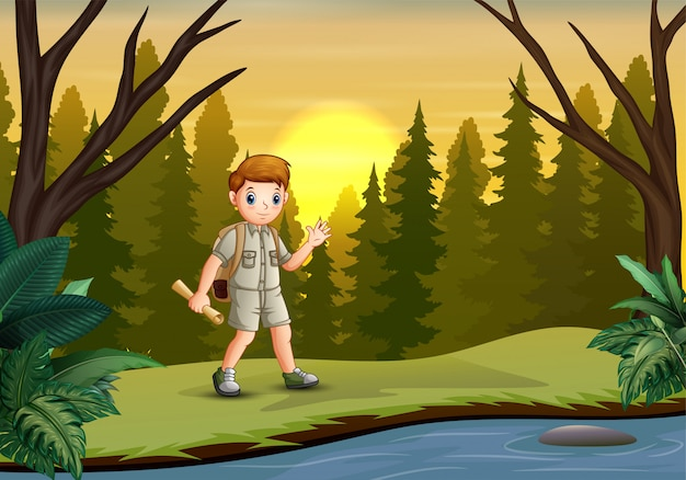 Scout boy exploring the forest with his maps