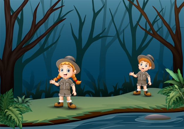 Scout boy and girl are talking at dark forest
