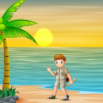 Scout boy going to camp site at sunset