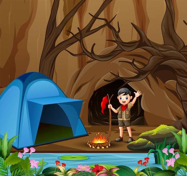 Scout boy on outdoor summer forest background with tent