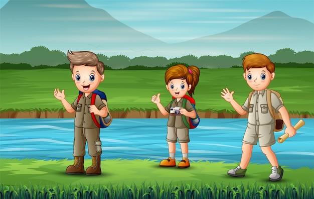 The scouts walking along the river