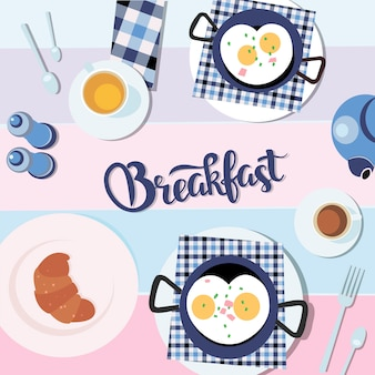 Scrambled eggs, croissant with cup of tea healthy food flatlay.