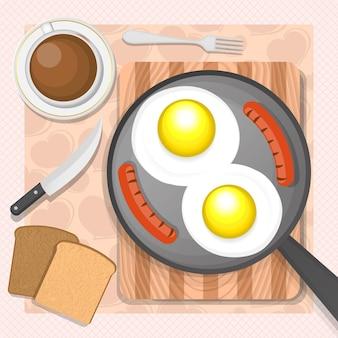 フライパンにソーセージを入れたスクランブルエッグ。朝の朝食。