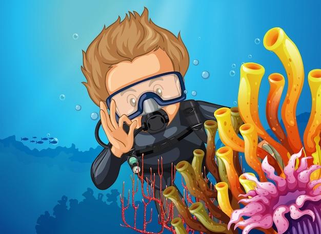 Scuba diver diving behind coral reef