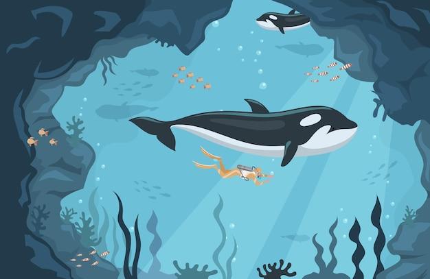 평평한 고래와 함께 바다에서 수영하는 스쿠버 다이버