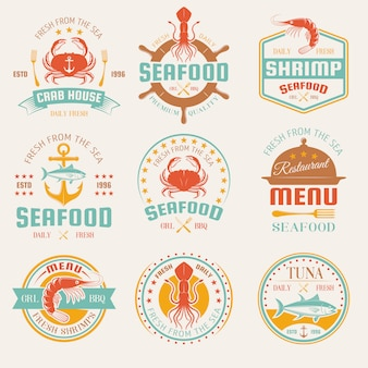 Seafood colored restaurant emblems with cutlery and cloche marine products anchor and helm isolated