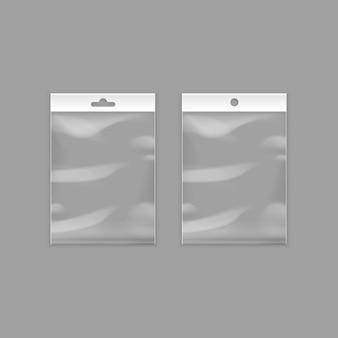 Sealed empty transparent plastic pocket bags with hang slot close up isolated on background