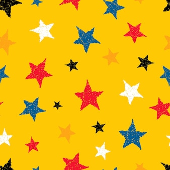 Seamless background of doodle stars. multicolor hand drawn stars on yellow background. vector illustration