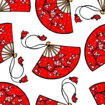 桜をイメージした美しい赤い日本のファンのシームレスな背景。手描きイラスト