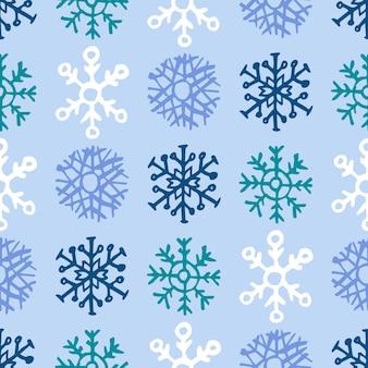 手描きの雪片のシームレスな背景。クリスマスと新年の装飾要素。ベクトルイラスト。