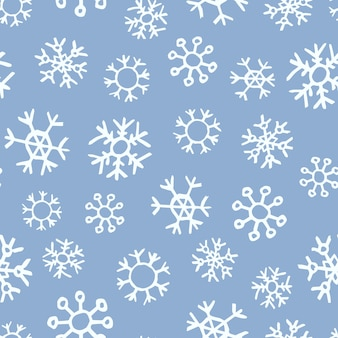 手描きの雪片のシームレスな背景。ベクトル図。