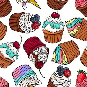 おいしいかわいいカップケーキのシームレスな背景。手描きイラスト