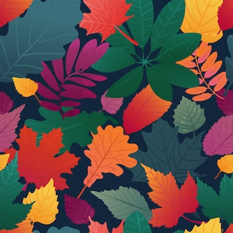 Бесшовный фон с рисунком осенних листьев. осенняя трава, веточка на черном фоне