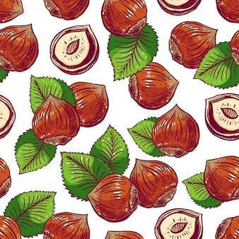 Бесшовный фон с фундуком и листьями. рисованная иллюстрация