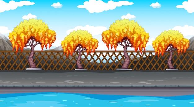 Бесшовный фон с деревьями вдоль дороги