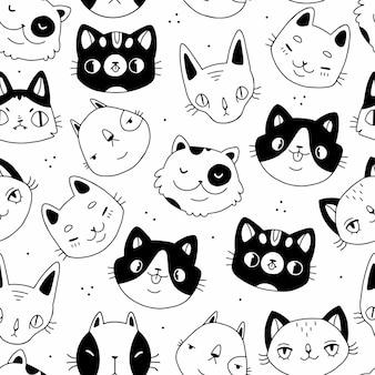 シームレスな黒と白の落書き漫画猫は、白い背景の上のシームレスなパターンに直面しています