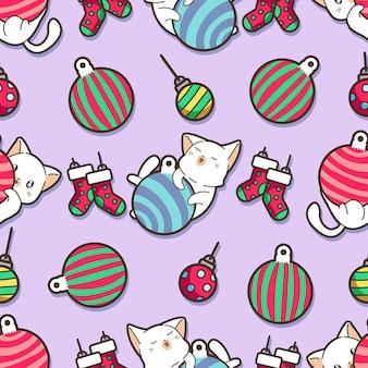 シームレスな猫とクリスマスボールのパターン