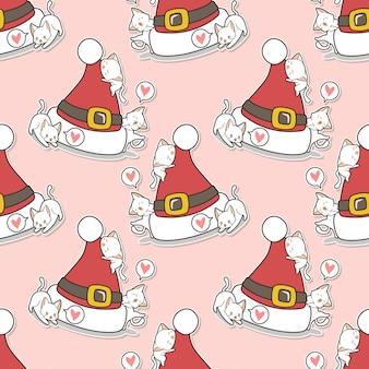 クリスマスの帽子のパターンとシームレスな猫