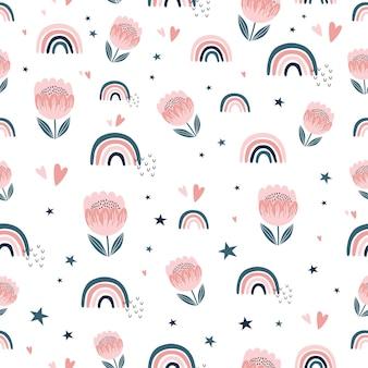 手描きの虹とかわいい花とのシームレスな幼稚なパターン。