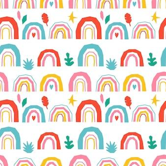 Seamless children's pattern with rainbow.